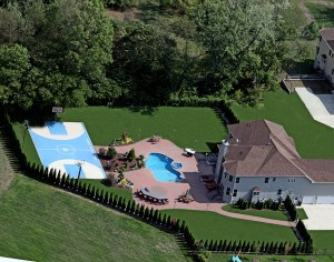 Luxury basketball court in backyard