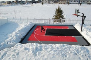 Snow in basketball Court in Backyard
